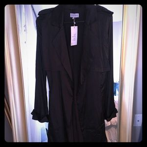 Black silk light weight jacket by Lioness